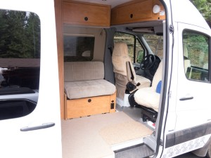 """Front seats swivel, and a table can be set up in """"living area""""."""