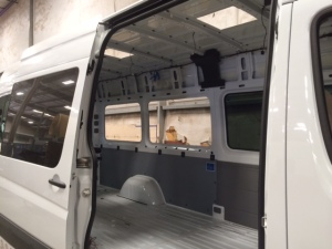 From Sportsmobile (SMB) factory: Cutting out windows
